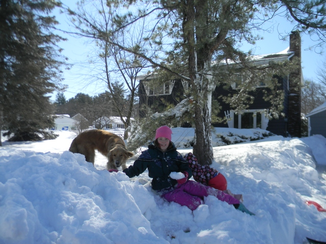 Hemi and girls in the snow in front of the house